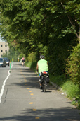 Cyclist on a bicycle path of the borough