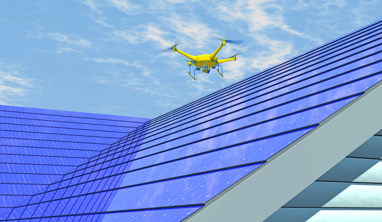 Computer generated render of UAV drone inspecting an integrated solar shingle roof. Fictitious UAV and generic solar panels; lens flare, depth-of-field and motion blur for dramatic effect.