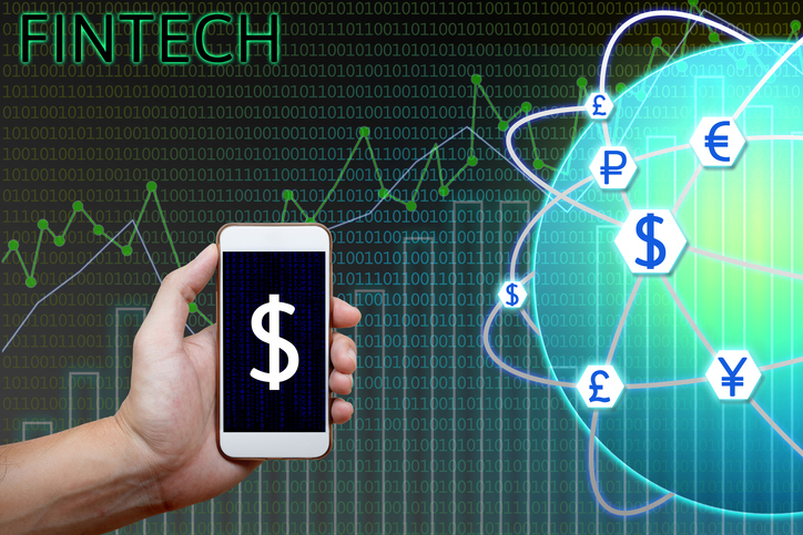 Financial technology (Fintech) concept. Man holding smartphone and charts, graph analyzing with currency global network and binary background.