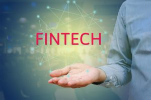 Financial and Technology (FinTech) concept. Businessman show text FINTECH on hand and networking.