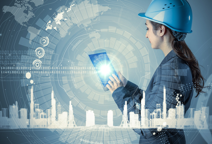 young woman engineer holding tablet PC. industrial technology concept. abstract mixed media.
