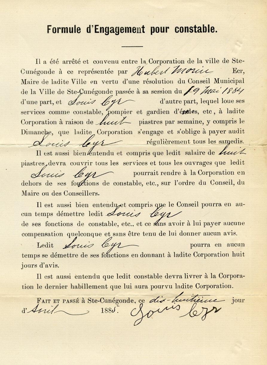 Photographie couleur d'un document imprimé avec certains espaces remplis à la main.