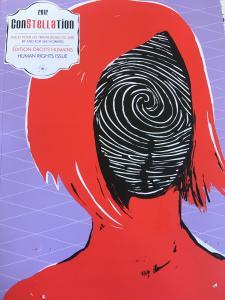 La page couverture d'une revue. On y voit la tête d'une femme de dos.