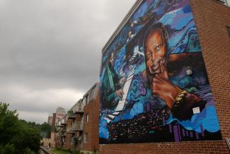 """Murale intitulée \""""Jazz born here\"""" au coin de la rue des Seigneurs et de la rue Saint-Jacques"""