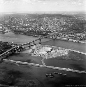 On procède au dynamitage de l'île Ronde et à la construction de la digue