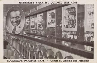 Carte postale montrant l'intérieur du café Rockead's Paradise et son propriétaire en médaillon