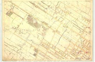 Détail d'un plan montréalais. On aperçoit, au centre à gauche, « Logan's Farm / (Military Exercising Ground) », entouré de petits symboles d'arbres.