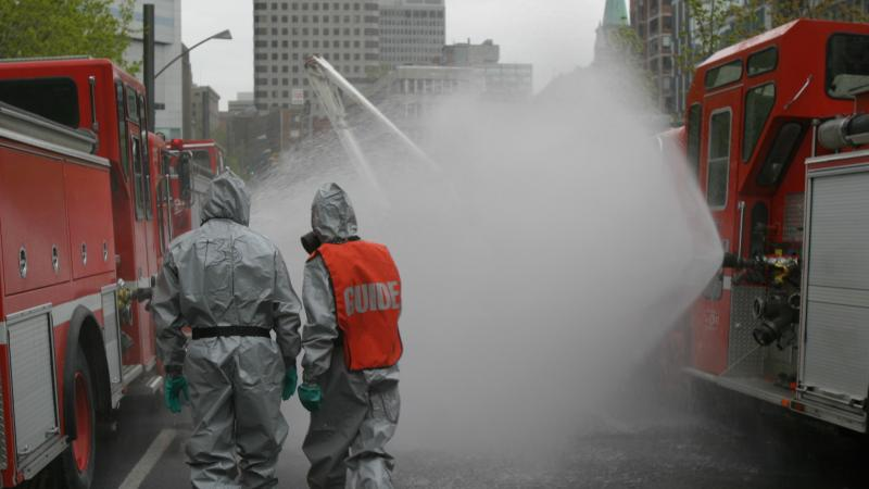 Two firemen during a dangerous materials simulation.