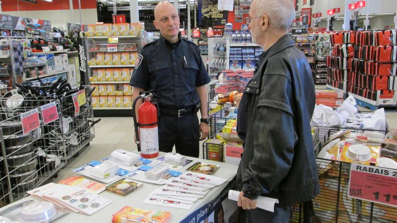 A prevention officer speaks during an awareness-raising activity at Canadian Tire