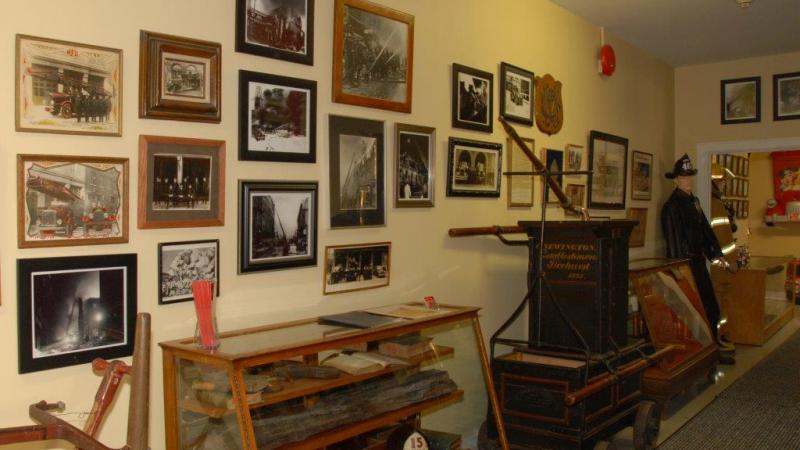 Photos and items from different eras at the Montréal Firefighters' Museum