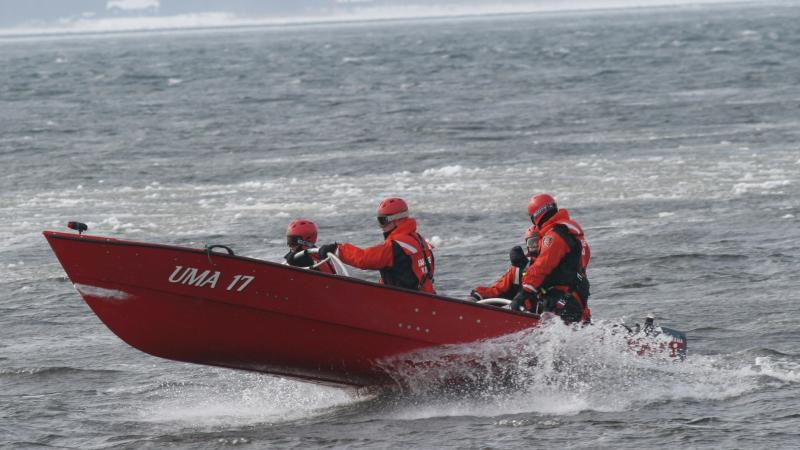 Ice rescue team in a boat during a simulation