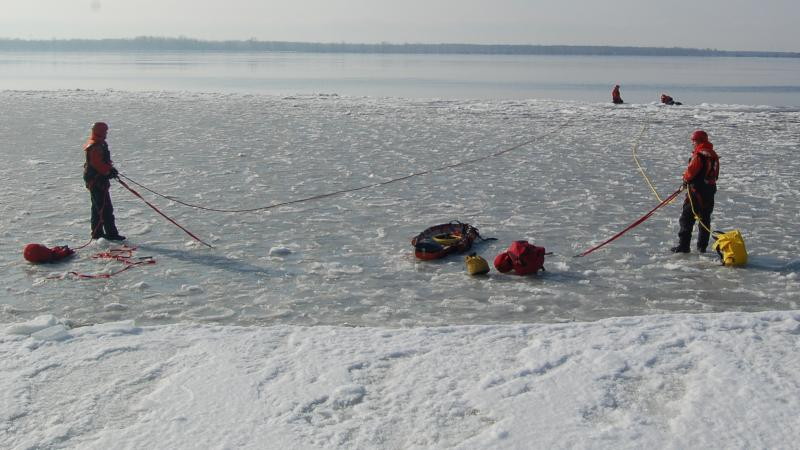 Firefighters during an ice rescue simulation
