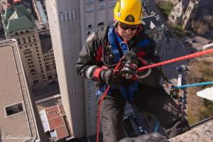 Firefighter performs a high altitude rescue