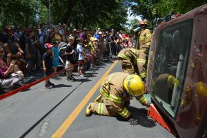 Firefighters demonstrate extrication to onlookers