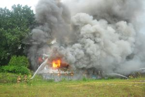 Firefighters work to put out a fire