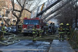Firefighters and a fire truck on site at a fire