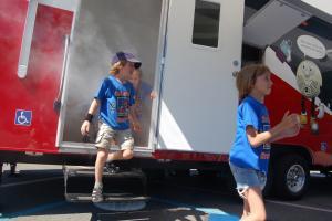 Children evacuate the SIMulator amid non-toxic smoke