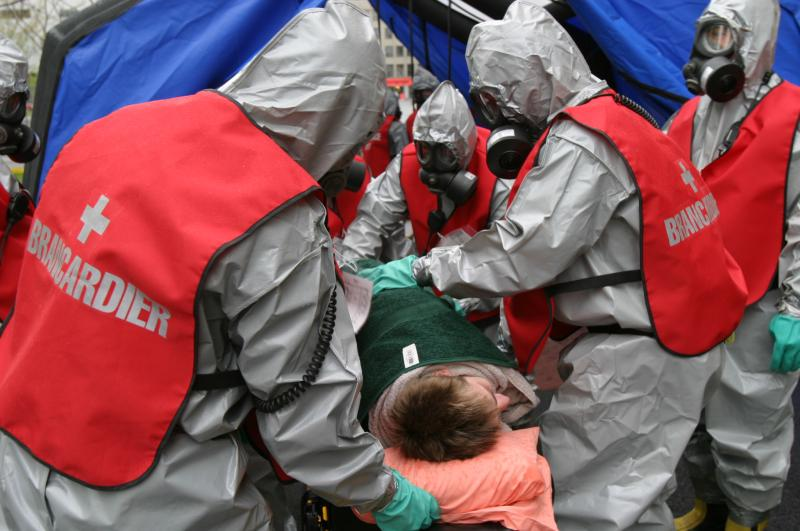 The dangerous materials team simulates an intervention on a resident.
